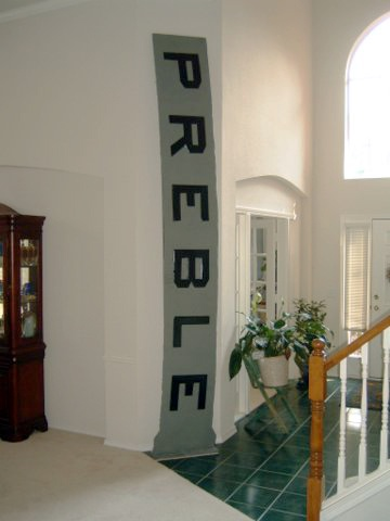 Tim, a regional facilities manager, keeps a piece of the USS Preble in the entryway of his home.
