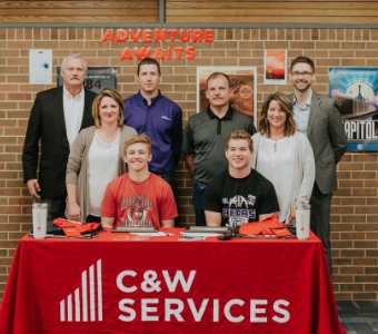 Trevor and Grant accept their scholarships from C&W Services and help close the trade-skills gap.