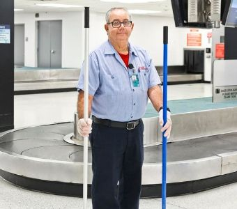 A C&W Services team member cleans the baggage claim area.