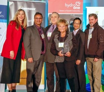 C&W Services, a facilities services company, is honored for its innovative green practices by the Government of Ontario and Energy Into Action