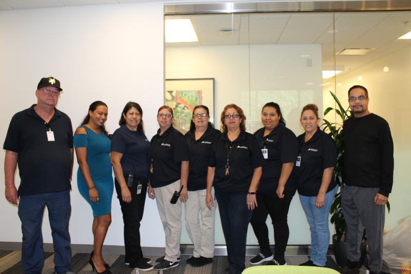 C&W Services facilities team members pose for a photo at a Hispanic Heritage Month event.